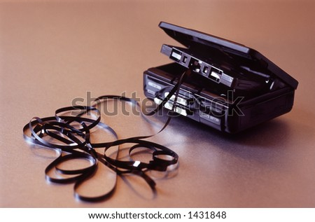 A cassette player with chewed tape