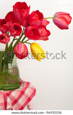 A Casual Arrangement of Bright Tulips with Room or Space for Copy, Text, or Your Words, all Against White Beadboard Background