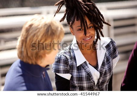 A casual portrait of a beautiful african american talking with friends