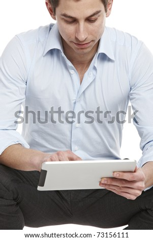 A casual young businessman working on tablet PC
