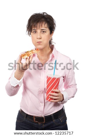 A casual young woman eating pizza and holding soda drink