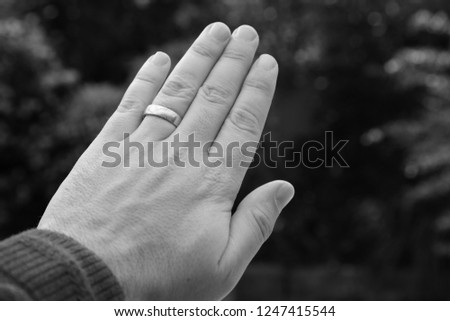 A Caucasian hand with a gold wedding ring. Marriage concept image.