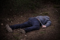 A caucasian man's dead body was found in the park. Murder in the woods. Murdered citizen. Crime scene