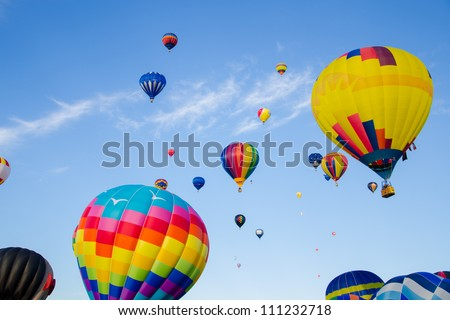 A celebration of hot air balloons on a summer day - stock photo