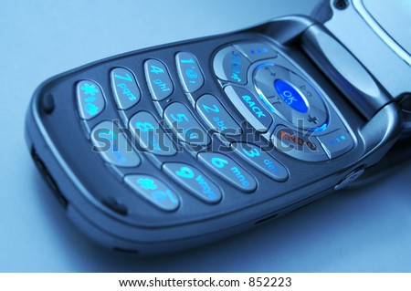 A cell phone key pad with cool blue lighting.