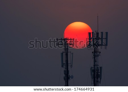 A cellular communications tower at sunset #174664931