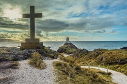 A Celtic and a plain cross dominate the skyline of Llanddwyn from many directions. One cross was erected at the end of the 19th Century, the other at the start of the 20th.