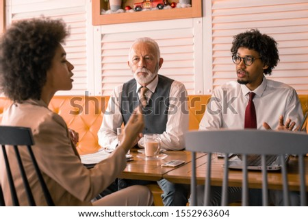 A CEO is about to make an important decisions while his two trusted employees discuss the details and options. The decision is hard and it is up to the CEO to save the day.