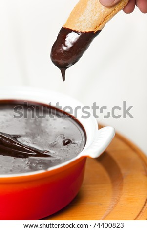 A ceramic pot of neapolitan sanguinaccio chocolate sauce and the italian savoiardi cookies