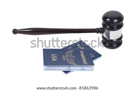 A ceremonial wooden gavel with a couple of passports - path included - stock photo