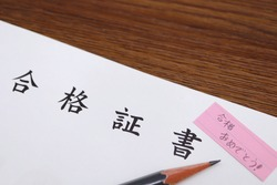 A certificate of acceptance in Japanese. Image of entrance examinations and qualification tests. Translation: Certificate of acceptance. Congratulations on passing the exam.