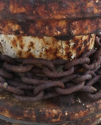 A chain and wall covered with rust.