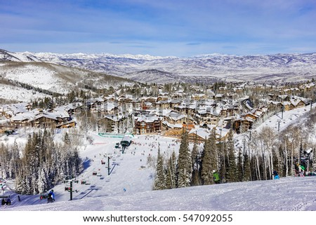 A chair lift brings skiers to top of ski slopes of  Deer Valley Ski Resort, near Park City and The Canyons.  Host to the 2002 Winter Olympics, this mountain is a short drive from Salt Lake City.. #547092055