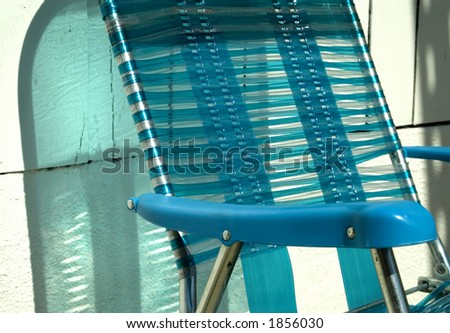A chair sits in the sun.