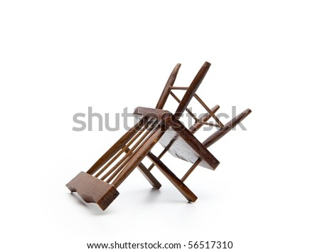 A chair upside down, isolated on white.