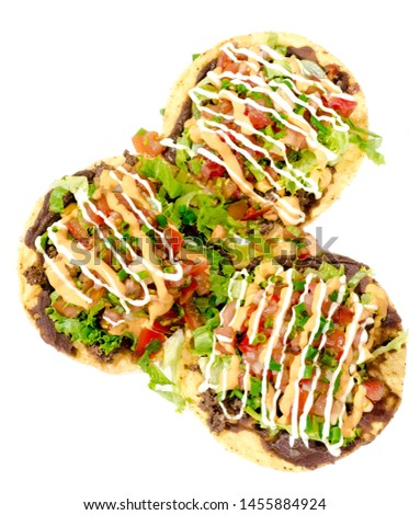 A chalupa is a specialty dish of south-central Mexico, This is prepared with fresh ingredients of tomato and lettuce, accompanied by beans, meat Molina, and a rich sauce of chedar cheese and custard #1455884924