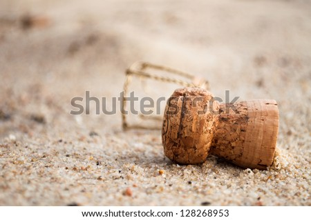 A champagne cork left in the sand