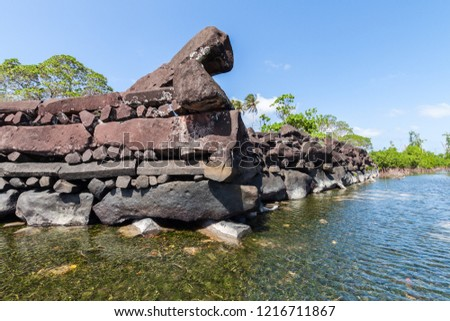 A channel and town walls in Nan Madol - prehistoric ruined stone city built of basalt slabs. Ancient walls were built on coral artificial islands in the lagoon of Pohnpei, Micronesia, Oceania.