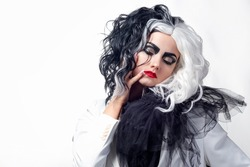 A charismatic unusual woman in a black and white outfit with black and white hair, a bold and stylish image of a villain for Halloween