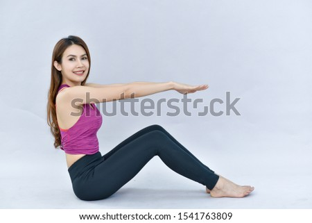A charming and charming young woman studying yoga and exercising at the Closeup Studio.