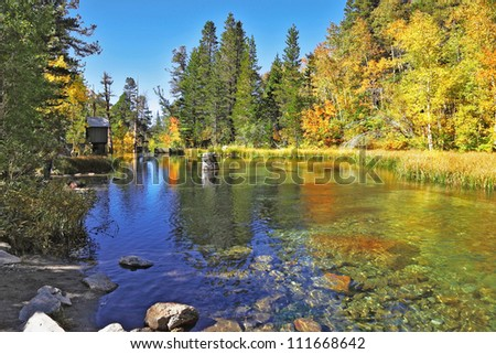A charming mountain lake in California. Clear blue sky reflected in the lake water