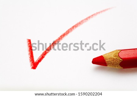 A check mark written in red pencil