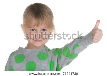 A cheerful little girl is holding her thumb up; isolated on the white background