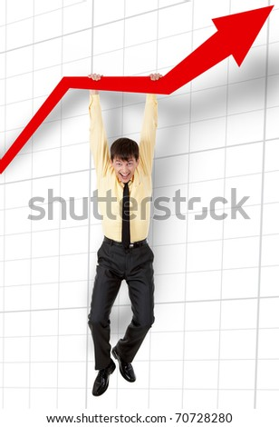 A cheerful man hanging on a financial graphic - stock photo