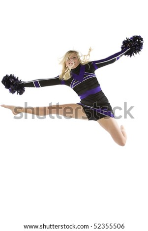 A cheerleader has jumped and is in the air with one leg out.