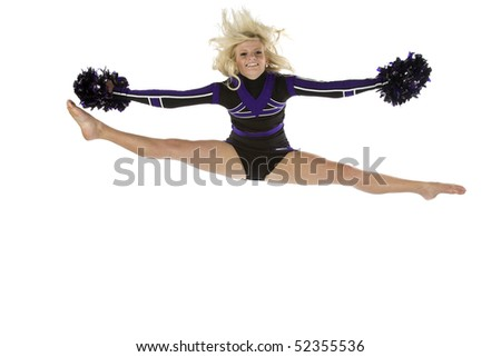 A cheerleader has jumped into the air in the splits position with a smile on her face.