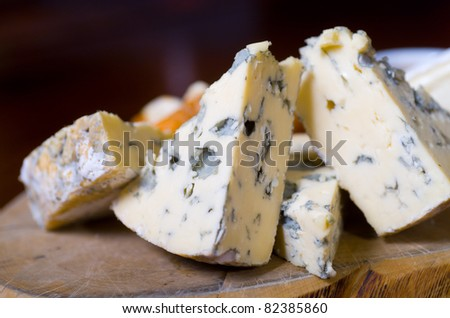 A cheese platter featuring blue vein and camembert cheeses