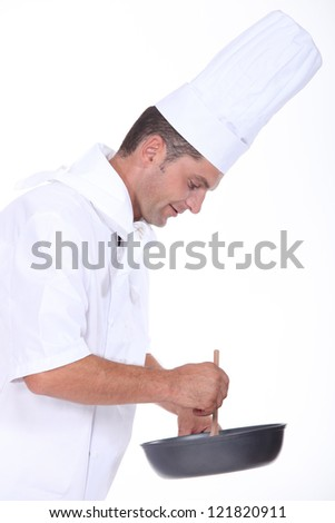 A chef preparing a meal
