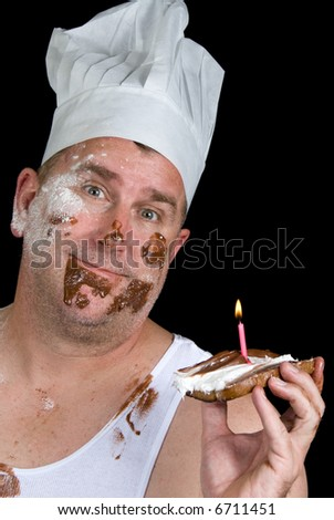 A chef shows off his failed cake consisting of a piece of burnt toast, with chocolate and vanilla icing and a birthday candle.