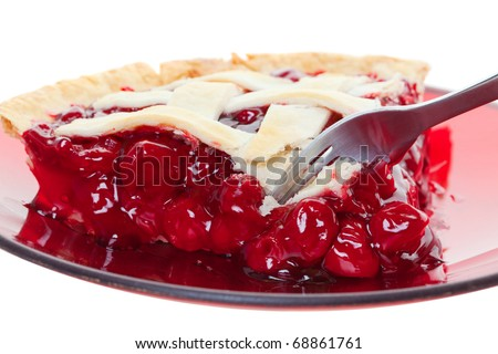 A cherry pie closeup cut into with a fork. Shot on white.