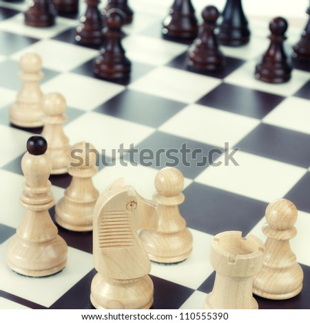 A chess board set up ready for a game,close up photo
