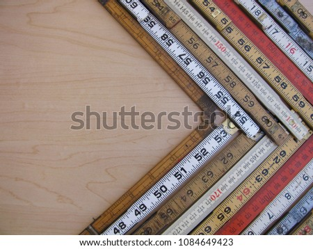 A chevron or arrow of rulers and scales in metric and inches is a graph representing accuracy, measurement, increase, growth and results with copy space.
