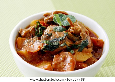 A chicken stew on a bowl with garnishing