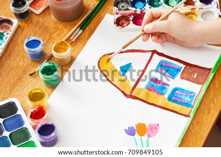 A child draws house and flowers by paint. Selective focus #709849105