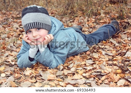 A child dreams of lying on fallen leaves