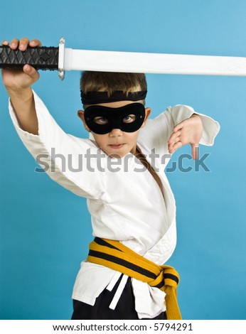 A child dressed in a makeshift costume for Halloween in an effort to look like a Ninja.