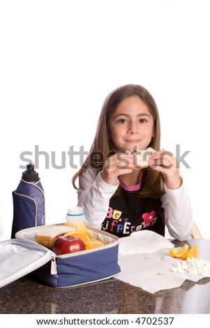 a child eating a healthy lunchbox lunch