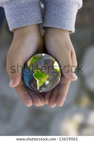 a child holds a globe, computer generated image, mapping image from NASA