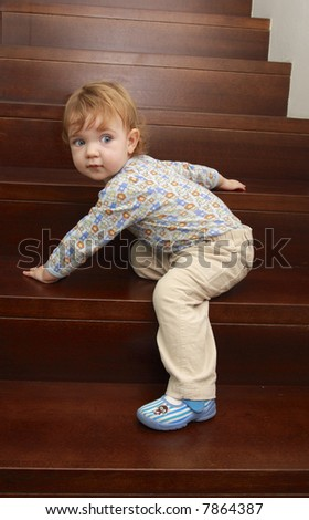A child is climbing up stairs.