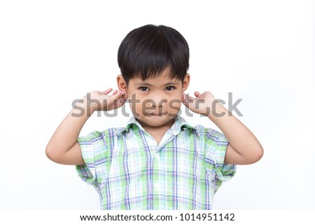 A child is standing and two hands touching the ears, with isolate white background. #1014951142