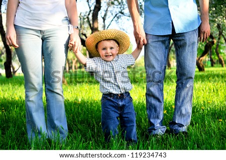 a child on the hands of parents - stock photo