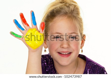 a child paints with finger paints. funny and creative.