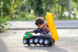 A child playing with a toy truck