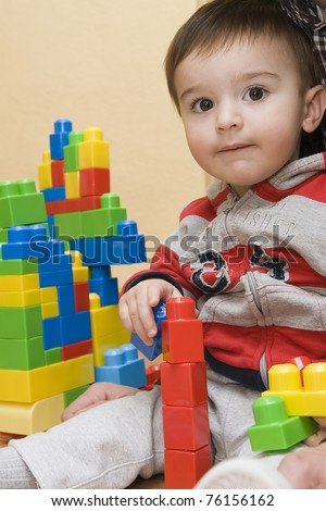 A child playing with colorful building blocks.