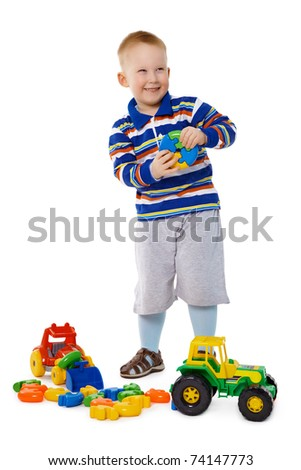 A child playing with plastic toys isolated on white background