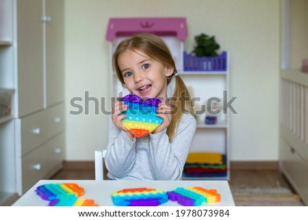 a child plays with a flapping fidget. popular children's flexible sensory toy develops fine motor skills, anti-stress, can be used for training with autistic people, popit toy